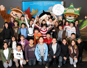 The Vancouver 2010 mascots celebrate the launch of the Royal Canadian Mint's Vancouver 2010 Commemorative Circulation Coins