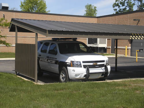 classic carports gives office carports a facelift. Black Bedroom Furniture Sets. Home Design Ideas