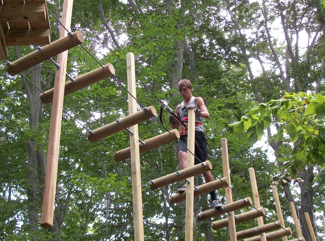 The Adventure Park at The Discovery Museum is more than just zip lines. It includes 150 bridges or challenge elements for kids, teens and adults. (Photo by Anthony Wellman)