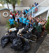 A happy Grand Cayman group taking stock of the trash they cleaned up and the good they have done on Earth Day.
