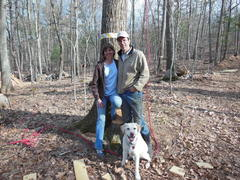 """Storrs land owners and Adventure Park partners, Lynn and Chris Kueffner with their Labrador, """"Rusty"""" at the Adventure Park site during construction. (Photo by Anthony Wellman)"""