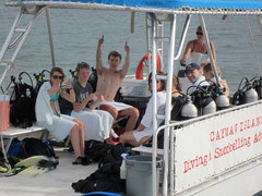 Aboard an Ocean Frontiers dive boat and doing a job they love are young ocean heroes.