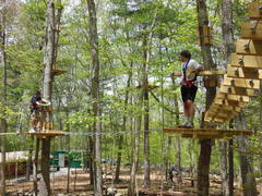 Two friends climb together at The Adventure Park at Storrs. Climbing with friends or groups is good for mutual support and team-building. (photo by Anthony Wellman)