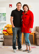 Jessica (right), a patron at Family Support Center's Life Start Village in Midvale, models one of the coats donated by Very Jane with Mike McEwan (left), Very Jane CEO.