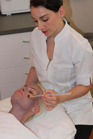 """A client indulges in the """"Om"""" Facial featuring HydroPeptide's new Gentle Rejuvenating Blueberry Peel and Nourishing Recovery Blueberry Mask at Julie Michaud Prettyology in Boston."""