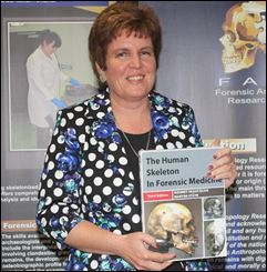 Prof Maryna Steyn with a recently published third edition of The Human Skeleton in Forensic Medicine