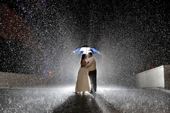 Photographer offers amazing rainy wedding day special.