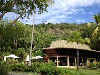 Ylang Ylang Beach Resort: Come and join us for a meal at our beautiful restaurant surrounded by green.