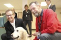 Minister of Health, Terry Lake, Bonnie and Adrian Renkers share their heart for promoting excellent senior care through therapies, such as visits from Dog Therapy teams