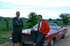 Jorge Gonzalez and Chris Hedgecock during their Route 66 Road Trip stop in Missouri and take a picture in front of their $1,000 1973 Cadillac.
