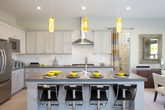 The new homes in Palm Desert feature beautiful open and modern kitchens.