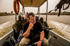 Robert Young Pelton travels by boat to find Riek Machar in South Sudan (c) 2014 Tim Freccia