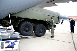 A model of the Medium Extended Air Defense System gets loaded onto a C-130J Hercules aircraft.