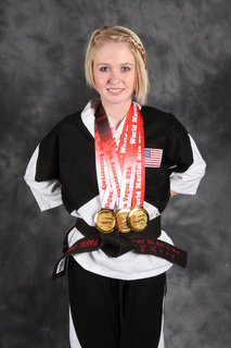 Paige Oswald With Three World Title Gold Medals