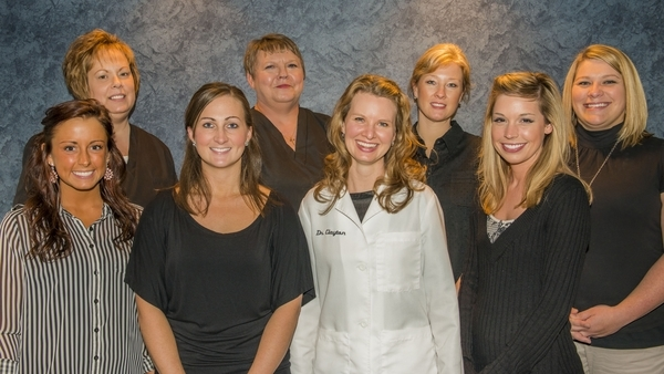 Dr. Sarah Clayton (center) volunteers with local free clinic to offer dental services to those in-need.