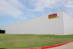 Insulated Metal Panels comprise the fourth wall of the Chicken Express Cold Storage Warehouse / Distribution Center in Burleson, Texas