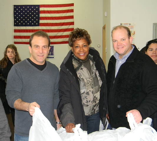 Atlantic Coast Media Group CEOs Thomas Shipley and Andrew Surwilo and State Senator Sandra Bolden Cunningham ready to hand out hundreds of turkeys in Jersey City