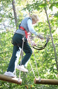 "Barbara Stetson, age 94, navigates a tree-to-tree ""element"" at The Adventure Park at The Discovery Museum. (Photo: Outdoor Ventures)"