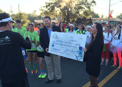 Michael Warren receives a check for the Boys & Girls Clubs of Marion County.