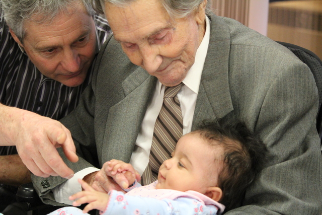 Siegfried Bartel turns 100 years old. Celebrating his birthday is his son and great granddaughter.