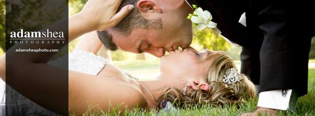 Bride and groom kissing on ground at Pamperin Park in Green Bay, WI.