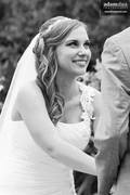Candid photo of bride during ceremony.  At Green Bay Botanical Garden in Green Bay, Wisconsin.