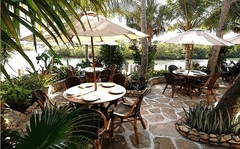 Waterfront dining is peaceful and relaxing, with Acoustifence noise deadening material strategically concealed within the property's lush tropical landscaping.