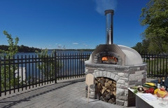 Pizza oven on the deck overlooking Lake Rosseau at JW Marriott The Rosseau Muskoka in Muskoka, Ontario, Canada.