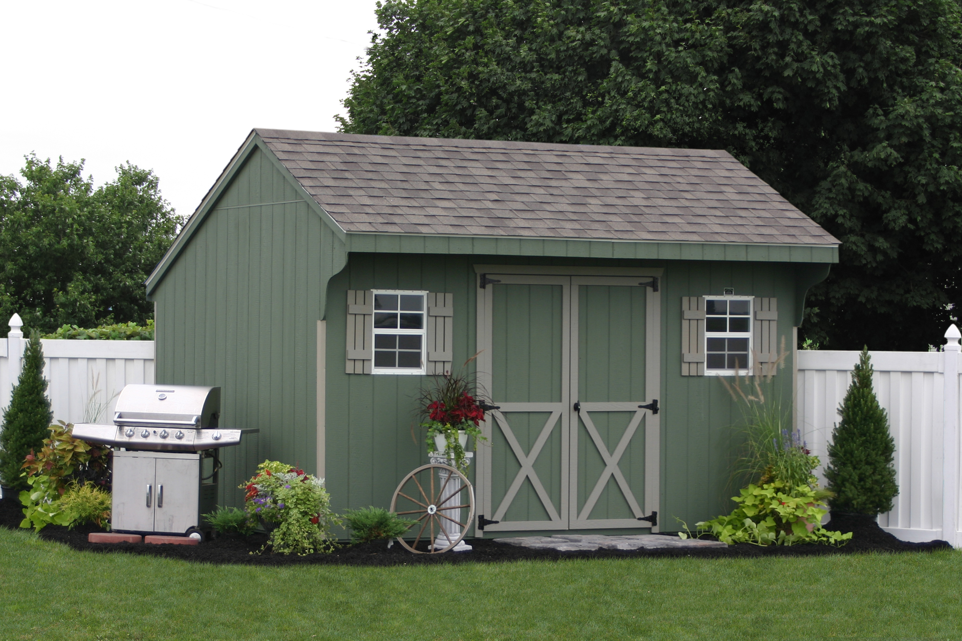 Assemble your own amish built storage shed or car garage for Garden shed pictures