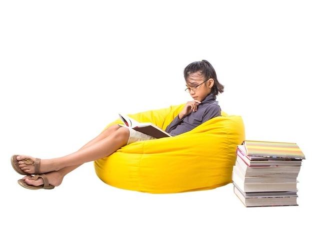 girl sitting on yellow beanbag