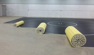 SportsGraphics introduces a Revolutionary New Line of Wrestling Mats: Roll Out Mats