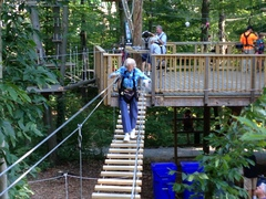 "Barbara starts her climb on ""Sunflower"" aerial trail. (Photo: Anthony Wellman, Outdoor Ventures)"