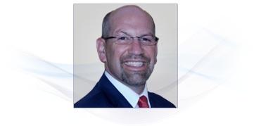 Wayne P. Kurtz, the President and CEO of Karlsberg International