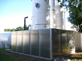 A 14-panel Acoustiblok Hurricane All Weather Sound Panel assembly was placed around the exhaust blower site.