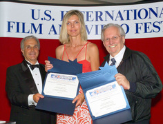 """Jo Christensen and Travis Pike accept awards for their production of """"Volunteers for Verdi."""""""