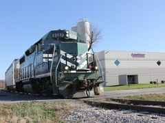 A train car filled with plastic polymers leaves the loading area on the north side of the building. Rail siding is one of Lastique's capabilities and they can fit 22 rail cars on two tracks.