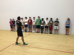 Lee Scott coaching a junior squash clinic at his academy located in the Louisville Boat Club. Scott offers a variety of classes for all ages and skill levels.