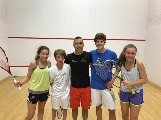 Lee Scott (center) with a few of his students. Scott came from England to start his own academy in Louisville in the hopes of helping to increase community involvement in squash.