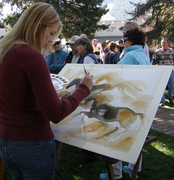 An artist participates in the QuickDraw event on the Town Square.