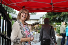 One of our staff welcomes people to the fair!