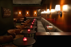 Mr. Lee's, located at 395 Goss Avenue, features a red leather bar and comfortably cozy seating arrangements throughout the cocktail lounge.