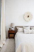 White may seem boring, but different shades and depths of the color can add a subtle complexity to a room like this bedroom designed by Bethany Adams - Certified Interior Designer in Louisville, KY.