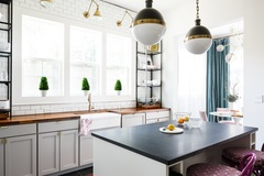 Bethany Adams, Certified Interior Designer, designed this entire historic home in Old Louisville, KY. Here you can see her open kitchen featuring a farmhouse sink and butcher block counter tops.