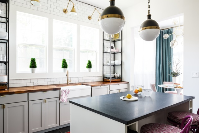 Bethany Adams, Certified Interior Designer, designed this entire historic home in  obsolete Louisville, KY. Here you can  contemplate her open kitchen featuring a farmhouse sink and butcher  obstruct counter tops.