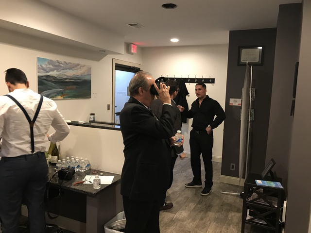 Guests view the VR Center at Cornerstone Realty's Staten Island Office.