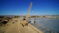 This is the largest crane of its kind in north Texas. The crane is performing tilt-up construction at General Motors' Automotive Logistics Center in Arlington Texas by Bob Moore Construction.