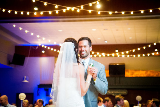 Bride and groom dance at a wedding reception at Lambeau Field in Green Bay, Wisconsin.  Adam Shea Photography captured the event.
