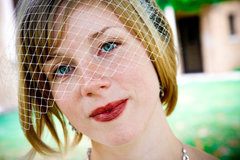 A bride looks into the camera, waiting for the ceremony to start.  Adam Shea Photography captured their wedding.