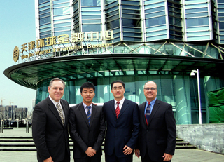 Leisure Quest's Mark Driscoll and Ted King pictured with LQI China's General Manager Michael Xue and Marketing Director Josh Du in front of the Company's new China Headquarters.