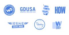 Logos for various awards won by Plaudit Design.